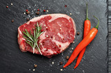 Fresh raw Prime Black Angus beef steak on stone background - 227170395