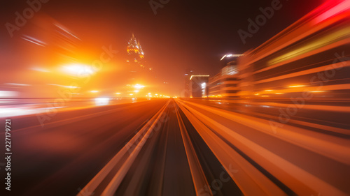 View from first railway carriage. Speed motion blur metro abstract background at night - 227179721
