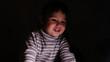 Emotional little girl says something in the dark