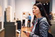 lady wearing earphone hear the voice guide