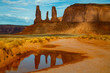 Monsoon rain created a reflecting pool along the Loop Road in Monument Valley Tribal Park of northern Arizona.