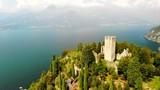 Drone shot of Castello di Vezio tower in Varenna, Italy - 227203389