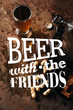 """top view of arranged peanuts, baked breads, bottle and glass of beer on rust tabletop with """"beer with the friends"""" inspiration"""