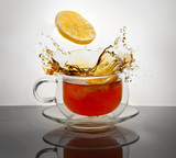 Tea with lemon in a transparent cup