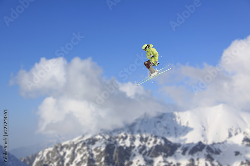 Flying skier on mountains. Extreme winter sport. - 227243551