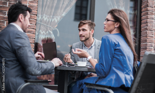 business colleagues discussing business issues at the coffee table