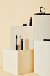 various makeup supplies lying on beige cubes