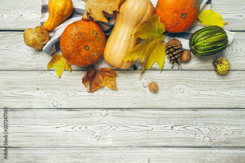 Pumpkin on old rustic wooden table.