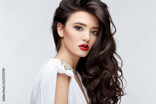 Leinwanddruck Bild Brunette asian girl with long curly hair