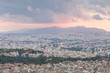 Quadro View of Athens and Salamina island from Lycabettus hill at sunset, Greece.