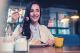 Good mood. Pleased woman expressing positivity while enjoying healthy food - 227290763