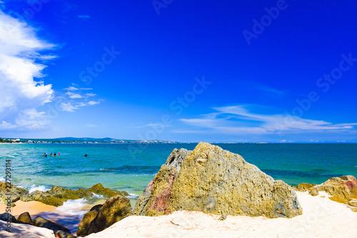 Leinwanddruck Bild sea beach sand stone