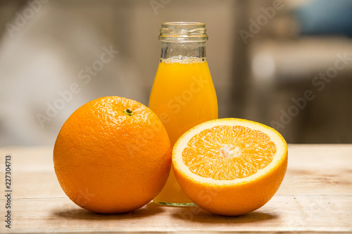Orange from above on wooden table - 227304713