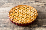 Homemade apple pie on wooden table - 227305772