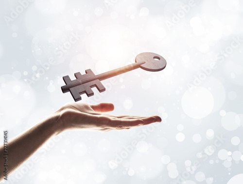 Key to new opportunities and success concept by symbol on hand.