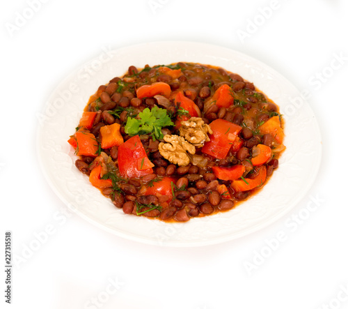 Plate of stewed beans with vegetables on white background - 227315518