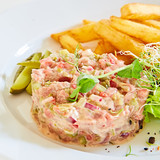 Meat tartar with french fries and vegetable salad. - 227317592