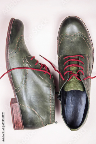 A Pair Of Khaki Color Oxford Man Shoes With Red Shoelaced On White Background Fashion