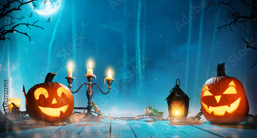 Leinwanddruck Bild Spooky halloween pumpkins in forest