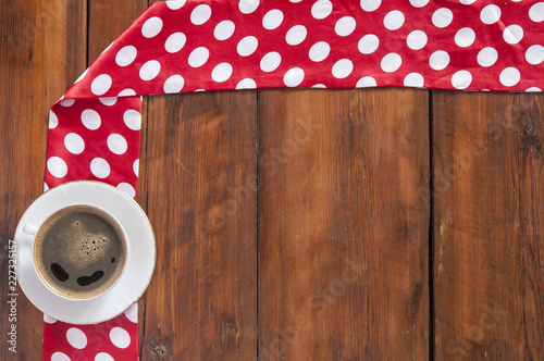 Wall mural White cup of coffee on vintage wood. Top view.