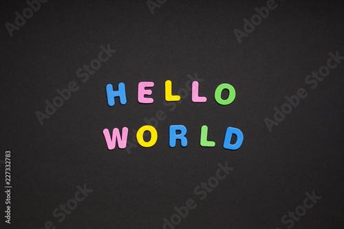 Hello world writing on black paper background