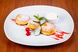 Delicious syrniki with cream - 227334528