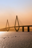 faro bridge in sunset light, the highway bridge over the Storstroem in denmark connects the islands and is a part of the vogelfluglinie (bird flight line), copy space - 227341148