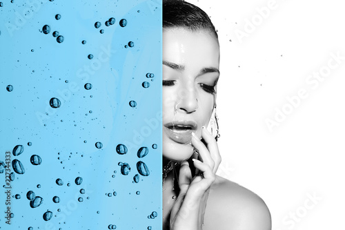 Foto Murales Beautiful woman skin care concept with hydrating water overlay