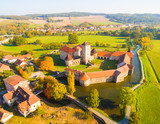 Aerial view to Svihov castle. Gothic architecture on river island. Beautiful landmark in national park Sumava, Czech Republic, Europe.- 227361721