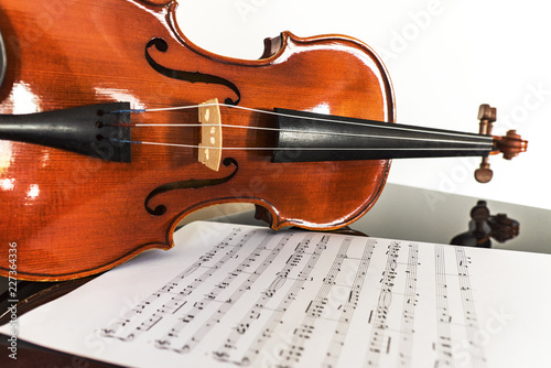 Violin with a music sheet, vintage - 227364336