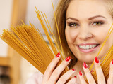 Woman holding long pasta - 227367154
