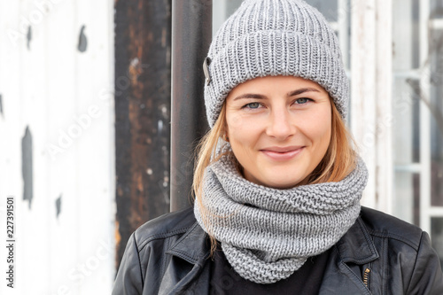 Leinwanddruck Bild Close up portrait of beauty autumn girl in frosty stylish coat .Beautiful young woman in  gray knitting hat, full lips and bright make up.