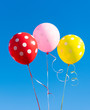 Quadro balloons against the blue sky