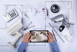 Architecture Looking At CCTV Footage On Digital Tablet