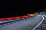 fotografia nocturna de carretera circulando coches - 227417359