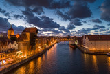Gdansk aerial view, citylight panorama in the evening with Zuraw and Soldek ship