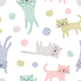 Childish seamless pattern with cats. Creative texture for fabric