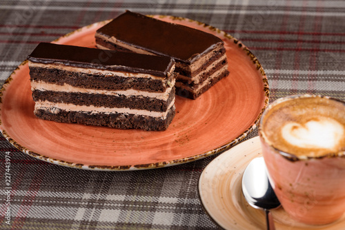 Wall mural cup of coffee and cake on table