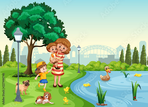 Mother and children at the park - 227446746