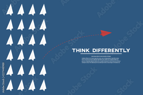Think different. Think differently concept. Red airplane changing direction. New idea, change, trend, courage, creative solution, innovation and unique way concept.