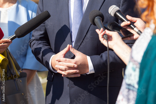 Reporters making press interview with politician or business person