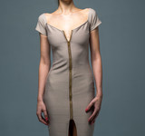 Model in a Tan Form Fitting Bodycon Dress Isolated on a Gray Background