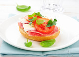 Sandwich with salami, cream cheese, tomatoes, camembert, fresh parsley and basil served on a plate. Home made food Symbolic image Concept for a tasty and healthy meal. - 227495929