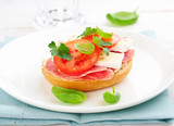 Sandwich with salami, cream cheese, tomatoes, camembert, fresh parsley and basil served on a plate. Home made food Symbolic image Concept for a tasty and healthy meal. - 227496125