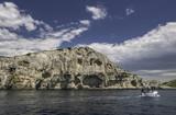 Touristic boat and cliffs in Kornati islands national park, Croatia - 227501765