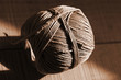 Still life with rustic rope ball on the wooden background.Sepia