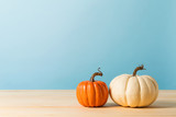 Collection of autumn pumpkins on a blue background - 227550546