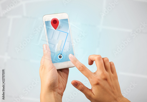 Leinwanddruck Bild Female fingers touching smartphone with map