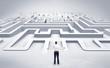 Leinwandbild Motiv Businessman getting ready to enter a 3D flat labyrinth concept