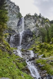 Waterfall in the forest in Austria near Heiligenblut am Großglockner